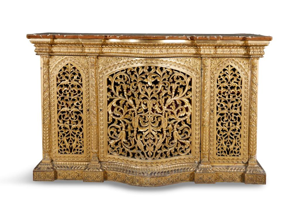 THE CASTLETOWN SUITE OF ANGLO-INDIAN FURNITURE AN ANGLO-INDIAN GILTWOOD TRIPTYCH FLOOR SCREEN, 19TH CENTURY, having twin out-folding panels, opening to a three panel screen, with fabric lined reserves enclosed by borders of tightly carved scrolli