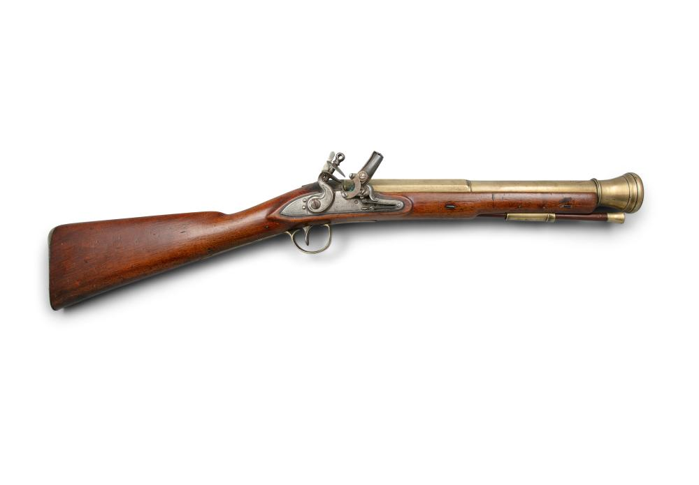 *AN IRISH FLINTLOCK BLUNDERBUSS, of military type fitted with Thomas Patent magazine primer, c.1814-15, the barrel struck with Irish Police registration number DU-5165 for Dublin * Lot imported under Temporary Admission. 13.5% import VAT will be ch