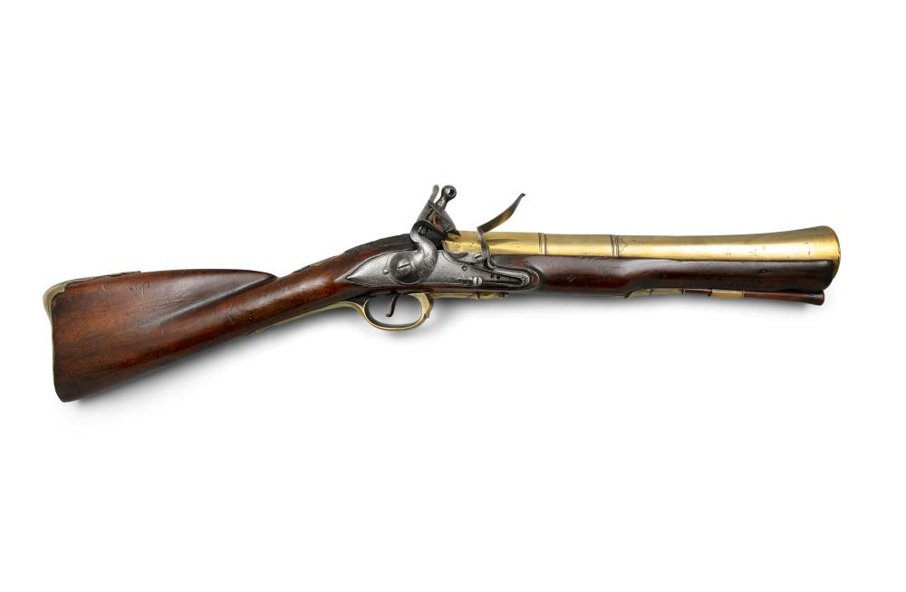*AN IRISH FLINTLOCK BLUNDERBUSS, by Trulock of Dublin, c.1750, the barrel struck with owner's name 'CLINTON' and Irish Police registration number DU, for Dublin * Illustrated: W. Keith Neal and D.H.L Back, Great British Gunmakers 1740 - 1790 * L