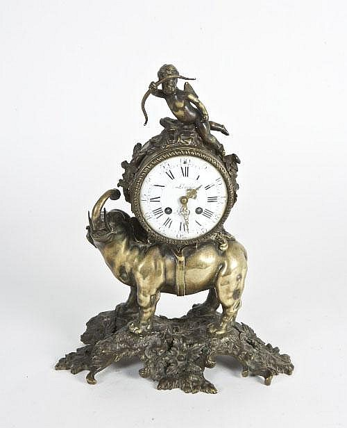A French bronze and brass mantel clock, the