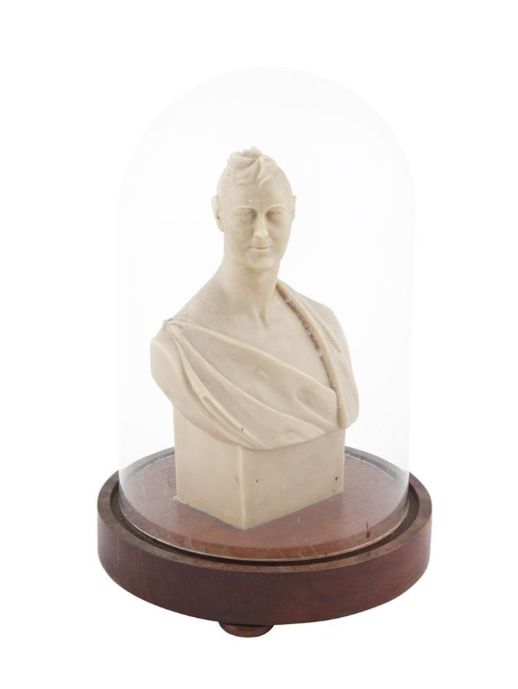Edwin Lyon ARHA (18/19TH CENTURY)Bust of Arthur St. George Esq.Wax bust on circular timber base and contained within glass dome, 31cm high including base, 25cm diameter including base Signed, inscribed and dated 30 April 1834Although Lyon never e