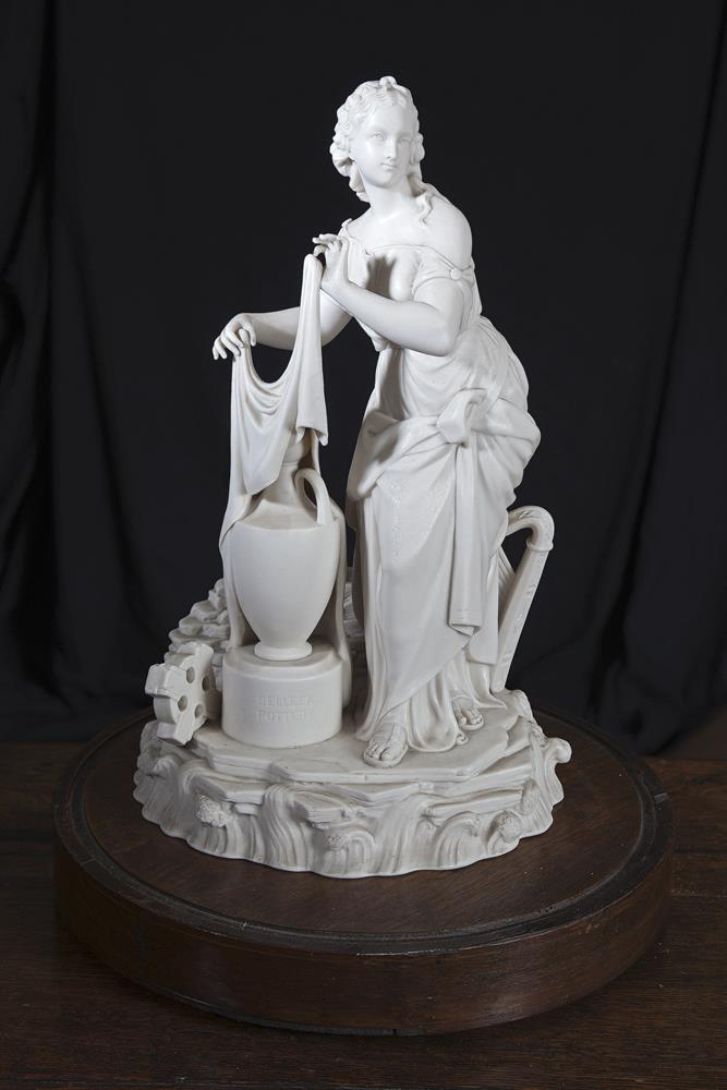 William Boyden Kirk (1824-1990)A Belleek china first period figure of Erin otherwise titled ''Erin Awakening from Her Slumbers'', designed by H. William Boyden Kirk (1824-1900), matte glazed. This allegorical piece represents the unveiling or introd