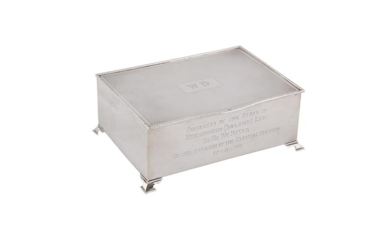 A LARGE RECTANGULAR SILVER CIGARETTE BOX, Birmingham 1946, the bowfront lid with engine turned decoration and cast rim, with initials W.D, further presentation inscription and dated 17-11-47, (c.530g). 12.5 x 17cm