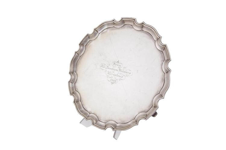 A LARGE SILVER SHAPED CIRCULAR SALVER, Birmingham 1939, with pie crust rim, the reserve engraved 'From the Sunbeam Workers, Christmas 1942', (c.1115g). 35.5cm diameter