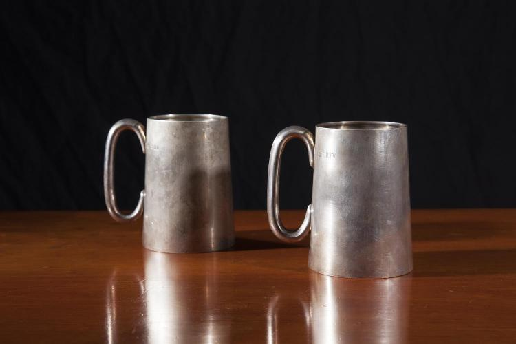 TWO SILVER MUGS, London 1917 and 1918, mark of Carrington & Co, of plain tapering form with gilded interiors, one bearing crest of the Worcestershire Regiment and inscribed with date 1st June 1794, (c.591g). 12cm high. (2)