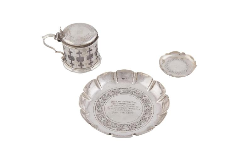 A VICTORIAN SILVER CIRCULAR MUSTARD POT, London 1849, with shallow domed lid, clear glass liner and pierced body; together with a twelve panel presentation strawberry dish, Dublin 1949, William Egan of Cork; and a small circular pin tray, William Ega