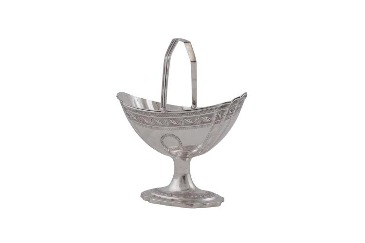 AN IRISH GEORGE III NEO CLASSICAL BRIGHTCUT ENGRAVED SILVER SUGAR BOWL, Dublin 1798, with swing handle and raised on spreading foot, (c.280g)