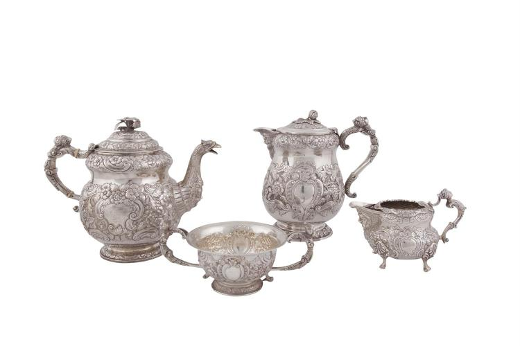 A MATCHED IRISH FOUR PIECE TEA SERVICE, Dublin 1823, mark of Edward Crofton, Dublin 1941, mark of West & Son, Dublin 1817, mark of William Nolan, and Dublin 1948, mark of Weir & Sons, comprising tea pot, hot water pot, cream jug and sugar bowl, all i