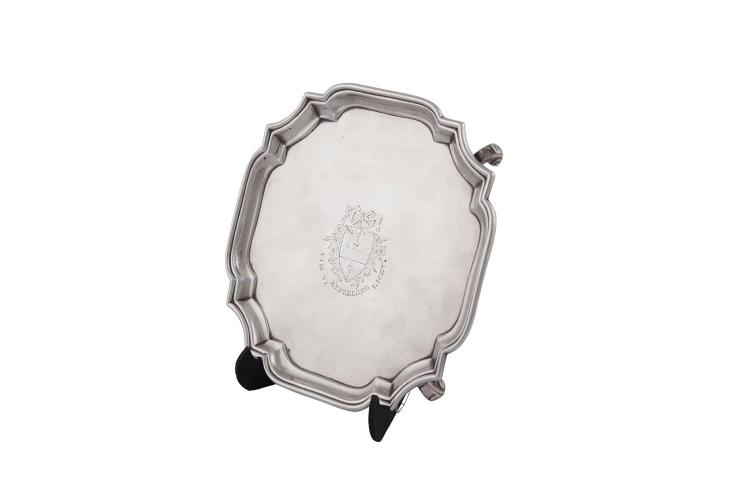 A GEORGE III STYLE SILVER SHAPED SQUARE CARD TRAY, London marks, with cavetto rim and raised on scroll feet (c.404.3g). 19 x 19cm