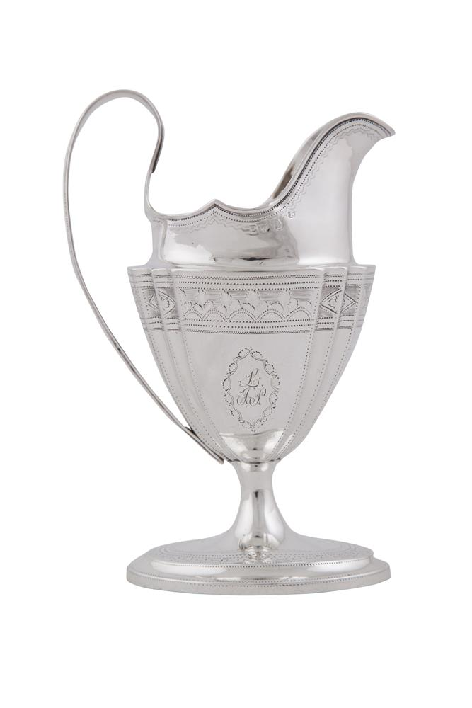 AN IRISH GEORGE III SILVER CREAM JUG, Dublin 1801, mark possibly that of Joseph Jackson, raised on spreading foot and with brightcut engraved decoration (c.189.7g). 16.5cm high