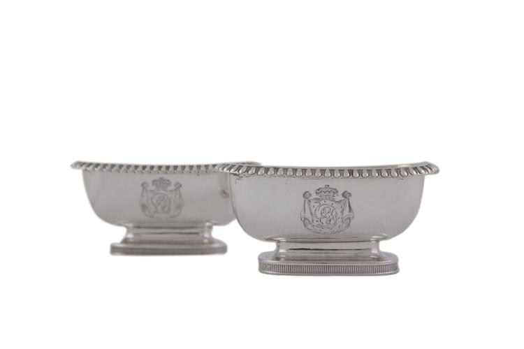A PAIR OF GEORGE III SILVER TRENCHER SALTS, London 1809, mark of Emes & Barnard, with gilded bowl, beaded rim and raised on rim foot with fluted border, crested, (108.5g)