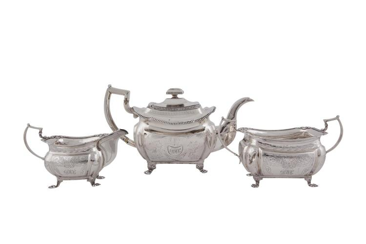 A COMPOSED IRISH GEORGE III THREE PIECE TEA SERVICE, Dublin 1815/16, mark of James LeBas (sugar bowl and cream jug) and mark of James Fry, of shaped rectangular form with brightcut engraved decoration and beaded borders, (c. 1244g). Tea pot 31.5cm wi