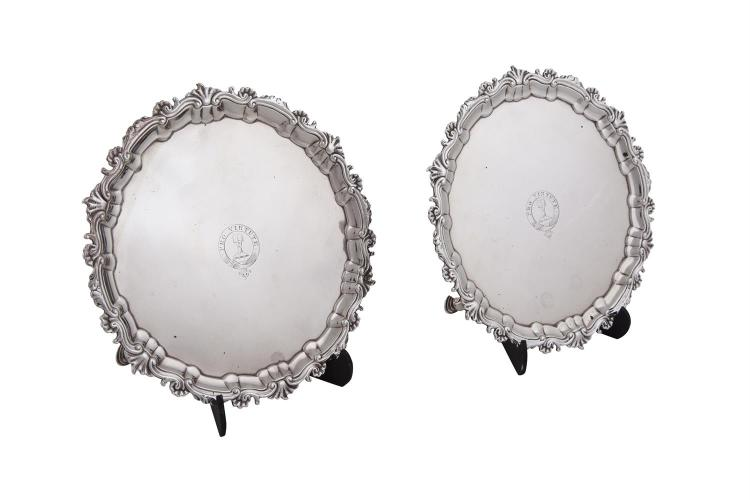 A PAIR OF IRISH GEORGE III SILVER CARD TRAYS, Dublin c.1770, mark of William Townsend, of shaped circular form with pie crust rim, crested with motto 'Pro Virtute'., (c.765g). 21.5cm diameter. (2)
