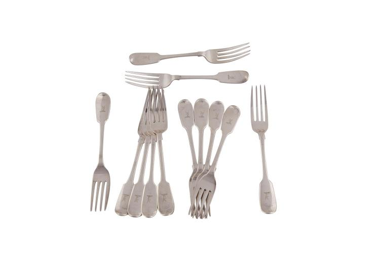 A SET OF TWELVE VICTORIAN IRISH TABLE FORKS, Dublin 1839, mark of Peter Walsh, with plain fiddle pattern handles, crested, (c.902g)