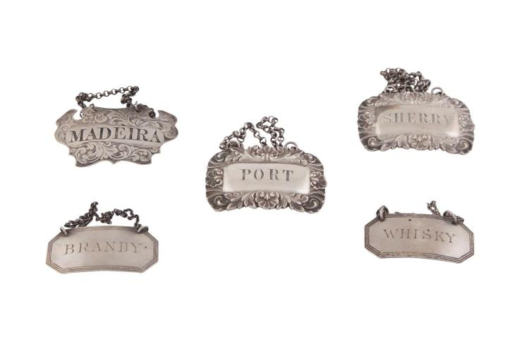 A COLLECTION OF SILVER DECANTER LABELS, including:- Two Victorian decanter labels, Birmingham 1841, mark of Taylor & Perry, inscribed Port and Sherry;- Another Victorian shaped decanter label, Birmingham 1845, inscribed Madeira;- And two Edw