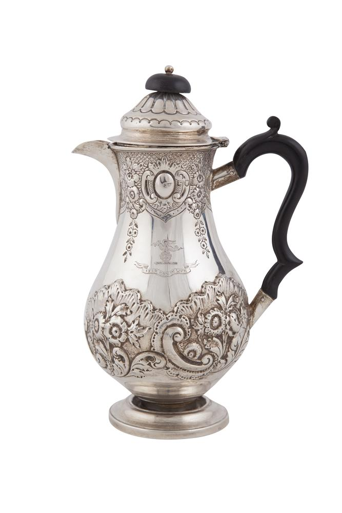 A VICTORIAN SILVER PEAR SHAPED COFFEE POT, London 1896, mark of Joseph Williams & Co., with domed hinged lid and applied ebon finial and 'C' scroll handle, the body decorated in the Rococo Revival taste, chased and embossed with foliate and shell mot