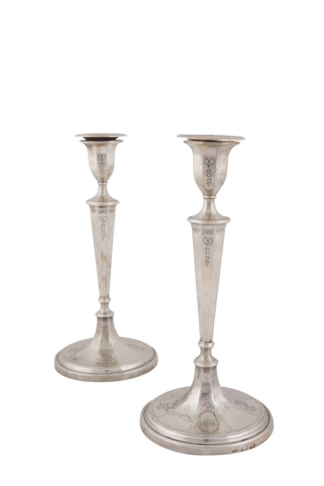 A PAIR OF GEORGE III SILVER CANDLESTICKS, Sheffield 1791, maker's mark of John Parsons & Co, the urn shaped sockets fitted with detachable sconces with maker's mark of John Green, Roberts, Mosley & Co, over octagonal tapering columns, raised on sprea