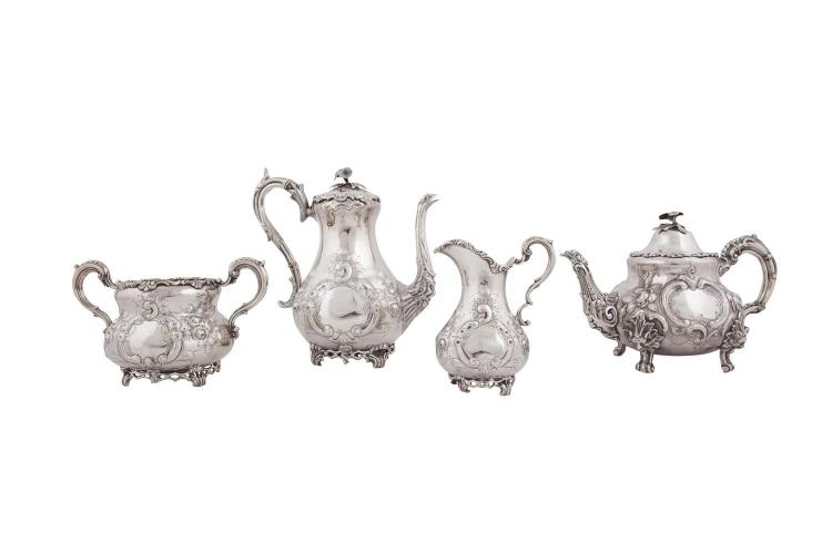 A MATCHED FOUR PIECE SILVER TEA AND COFFEE SERVICE, Dublin 1867 and '68, mark of John Smith, the teapot London 1876, mark of Martin, Hall & Co, comprising coffee pot, tea pot, sugar bowl and cream jug, each of conforming design, chased and embossed w