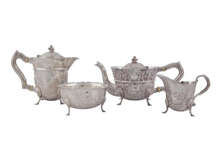 A FOUR PIECE IRISH SILVER TEA SERVICE, Dublin 1966, mark of J.W, comprising tea pot, hot water pot, cream jug and sugar bowl, the tea and hot water pots applied with ornithological swan finials and plain 'c' scroll handles, each piece with wavy rim,
