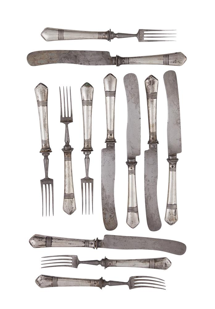 A SET OF SIX WHITE METAL HANDLE KNIVES AND FORKS, with ring turned handles