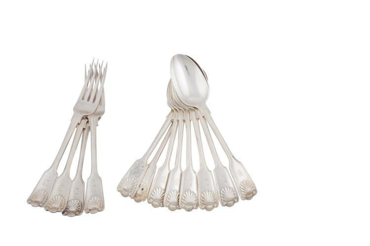 A SET OF EIGHT EDWARDIAN SILVER FIDDLE AND SHELL PATTERN DESSERT SPOONS, London 1908, mark of Josiah Williams & Co.; together with eight matching forks, all engraved with initial, (c.1073g all in). (16)