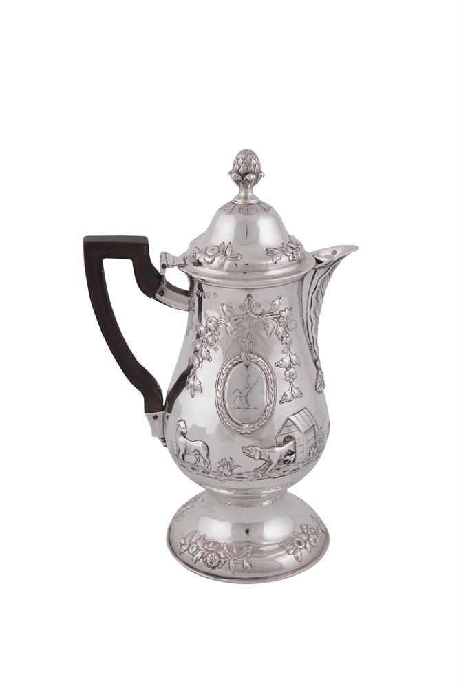 AN IRISH GEORGIAN SILVER COFFEE POT, Dublin 1773, mark of John Calderwood, of circular baluster form decorated with repousse, chased and engraved animal and flower motifs, raised on rim foot, (c.808.5g). 30cm high