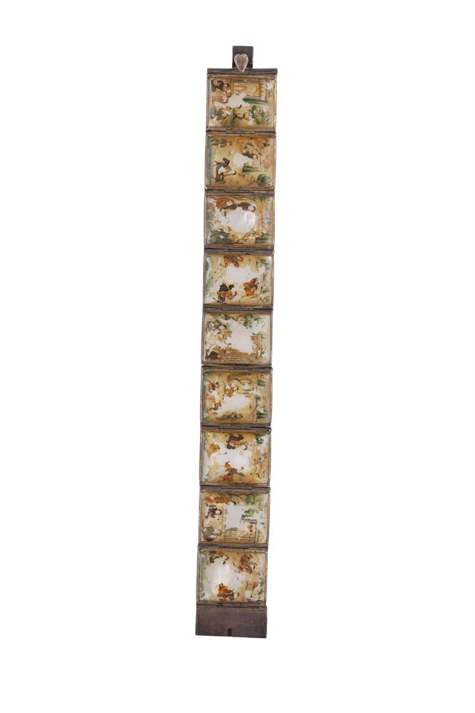 A CHINESE IVORY PLAQUE BRACELET, each hand painted ivory plaque depicting figures in pastoral scenes within a silver setting. Length approx. 18cm (losses to paintwork)PLEASE NOTE: THIS ITEM CONTAINS OR IS MADE OF IVORYBidders should be advised that