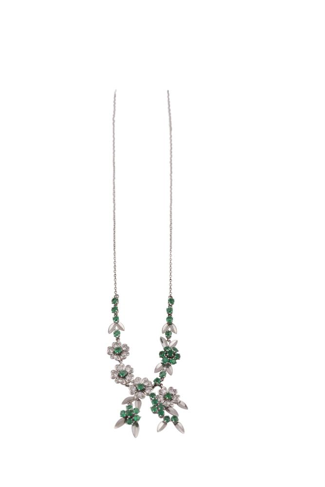 A GREEN GEMSTONE AND DIAMOND NECKLACE DEPICTING FLOWERS, mounted in white metal