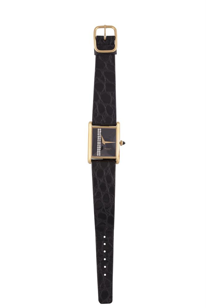 A STAINLESS AND GOLD PLATED LADY'S WATCH BY RAYMOND WEIL, with black leather strap signed Raymond Weil, with maker's box