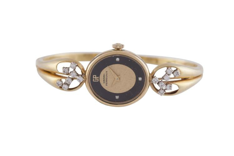 AN 18 CARAT GOLD AND DIAMOND BANGLE WATCH BY GERARD PERREGAUX