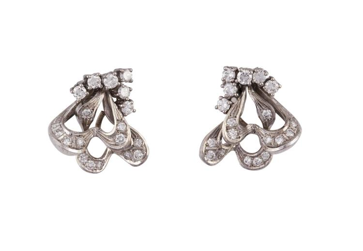 A PAIR OF DIAMOND EARCLIPSEach of openwork scroll design, set throughout with round brilliant-cut diamonds, diamonds approximately 1.00ct total, length 1.7cm