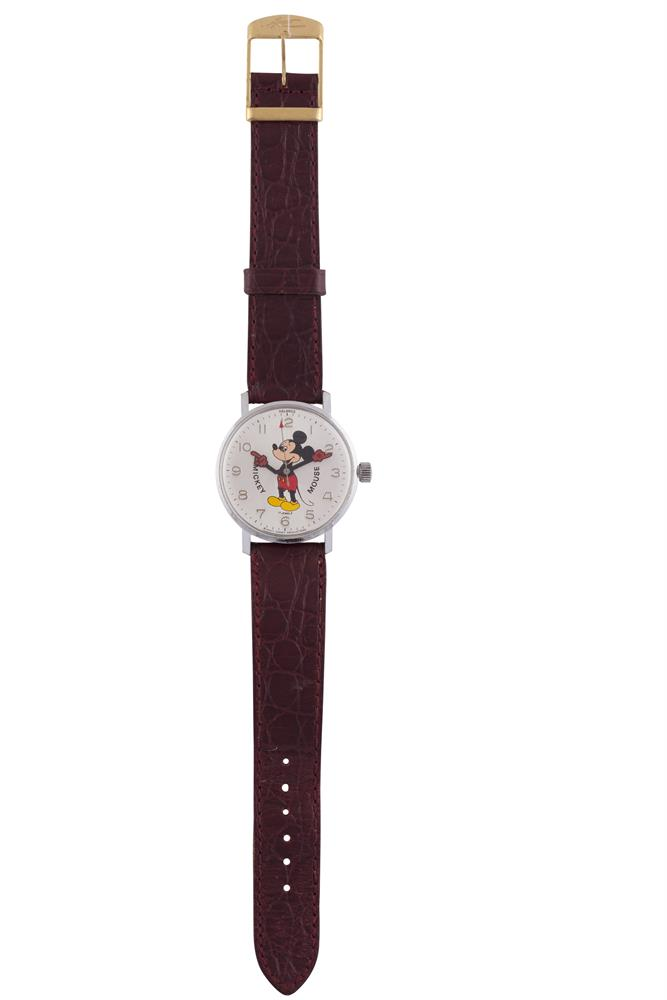 A MICKEY MOUSE STAINLESS STEEL WATCH, hours and minutes, on leather strap