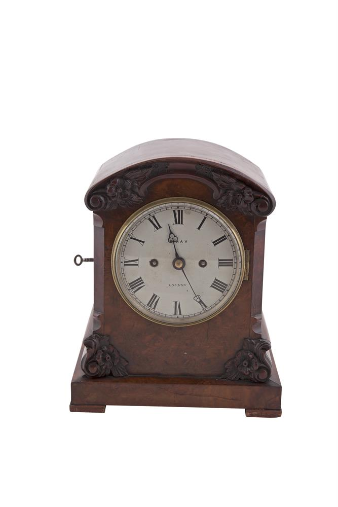 A GEORGE IV MAHOGANY CASED BRACKET CLOCK, by May, London, the domed top above a painted metal disc, the case decorated with carved acanthus fronds. 33cm tall