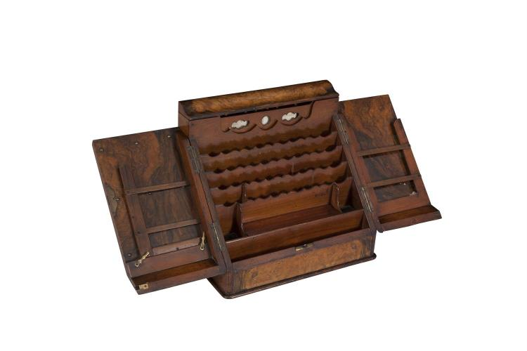 A VICTORIAN WALNUT SLOPE FRONT STATIONERY BOX, the interior fitted with compartments and stationery dividers. 40cm wide x 37cm high
