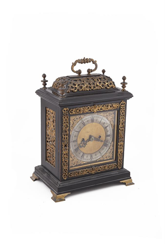 ***PLEASE NOTE: ESTIMATE SHOULD READ €2,000 - 3,000***A 19TH CENTURY EBONISED TIMBER CASED MANTLE CLOCK, of rectangular form, the case with foliate cast brass handle to the domed top, decorated allover with applied cast pierced mounts, the matted gi