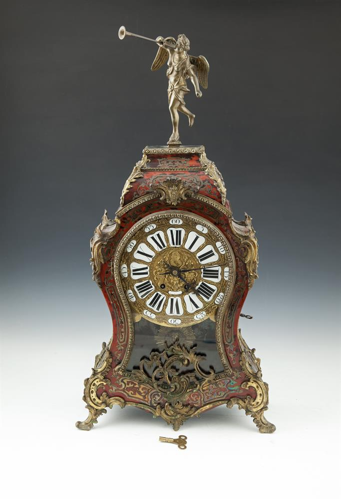 A LOUIS XV SCARLET BOULLE-WORK AND ORMOLU BRACKET CLOCK, the gilt dial set with individual enamel numerals, above a sunburst pendulum, the frame cast with leaf scrolls and beading. 75cm high