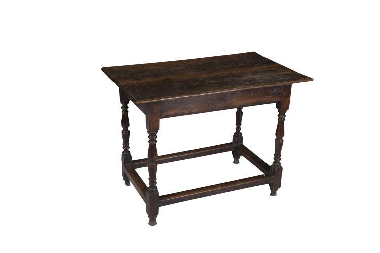 AN EARLY GEORGIAN OAK RECTANGULAR SIDE TABLE, raised on baluster turned and block supports with stretcher. 88 x 54cm