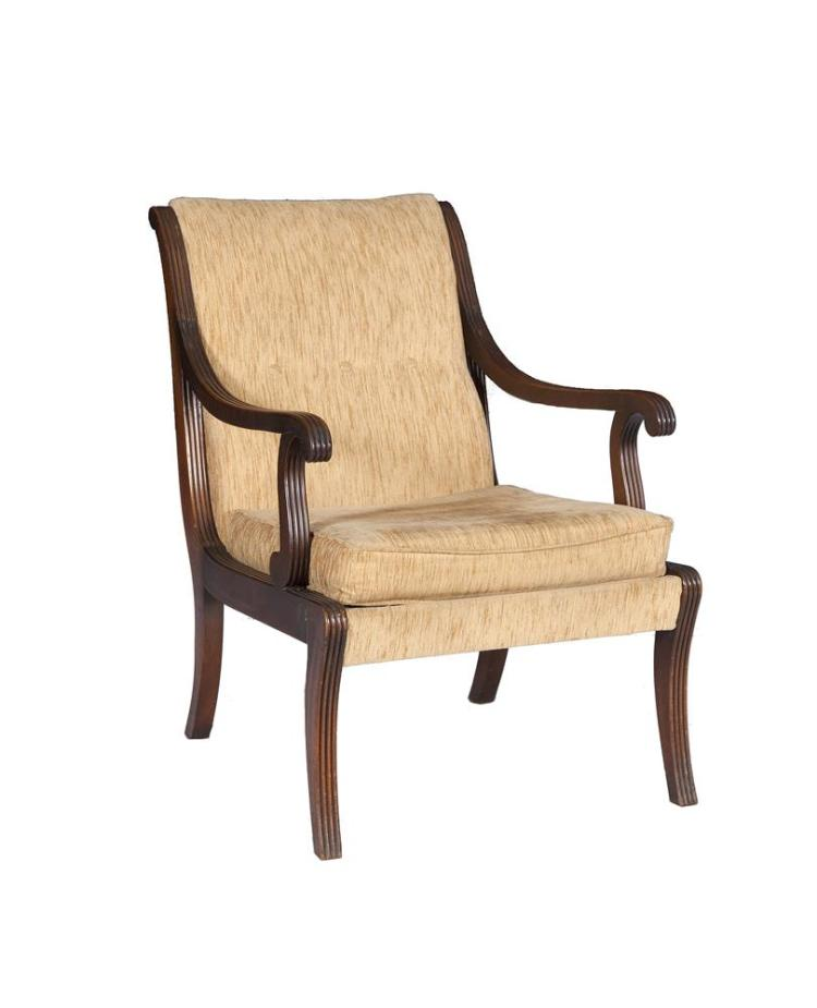 A PAIR OF GEORGE IV STYLE MAHOGANY FRAMED ARM CHAIRS, the reeded frame with scroll back and arm supports on sabre legs