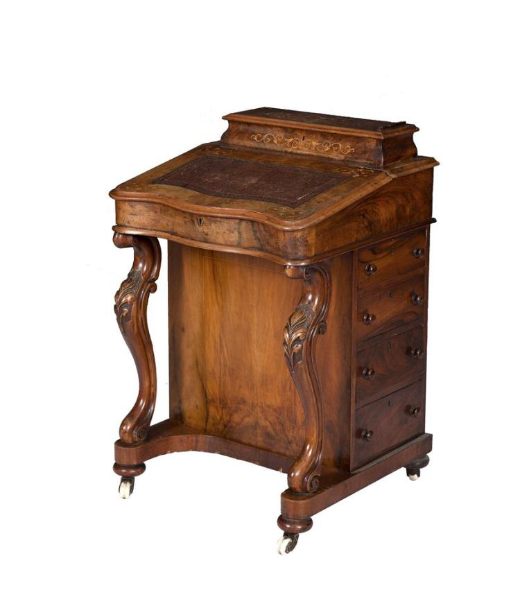 A VICTORIAN INLAID WALNUT DAVENPORT DESK, the slopefront top with raised pen tray and tooled leather scriver, on scroll front supports and having four drawers to the side (two missing). 54cm wide, 87cm tall