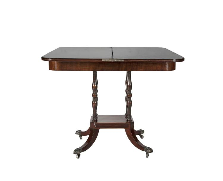A REGENCY MAHOGANY AND ROSEWOOD BANDED FOLD-OVER TOP CARD TABLE, with brass string inlay, on quadruple turned supports, the platform base on short sabre legs with claw feet. 91.5cm wide
