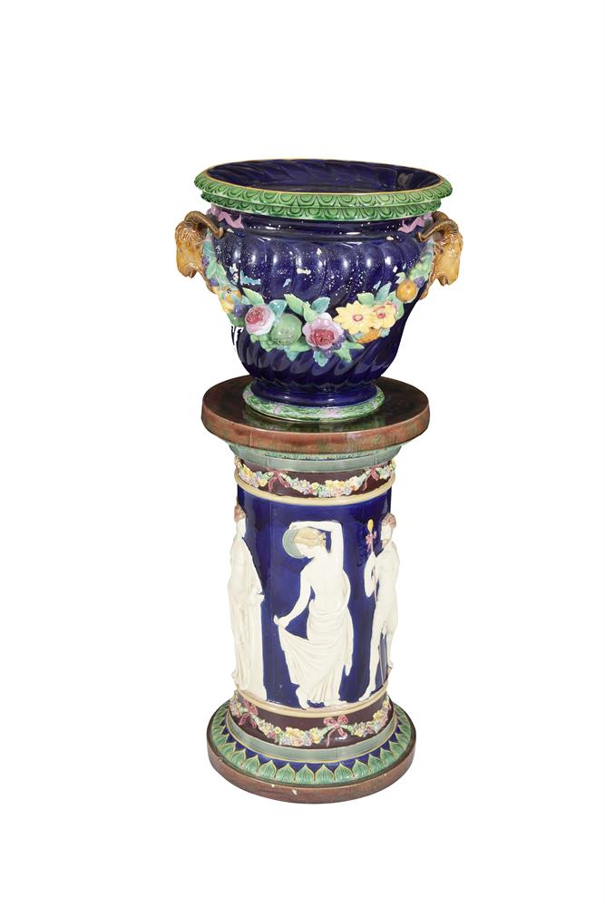 A 19TH CENTURY MAJOLICA JARDINIERE, decorated on blue ground, with an associated column stand