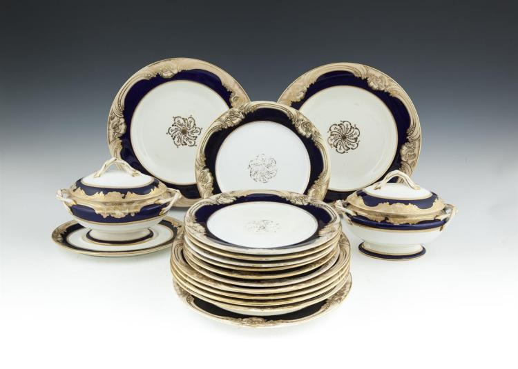 A 19TH CENTURY COALPORT CHINA PART DINNER SERVICE, comprising a selection of dinner plates, side plates, soup bowls and vegetable tureens, each decorated in deep blue with gilt scroll borders, factory mark to base