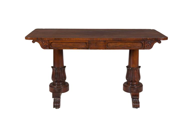 A WILLIAM IV ROSEWOOD RECTANGULAR LIBRARY TABLE, the top with rounded carving above plain frieze, raised on turned tapering side supports with lotus curved collar, each on a platform and raised on scroll legs. 132 x 63cm