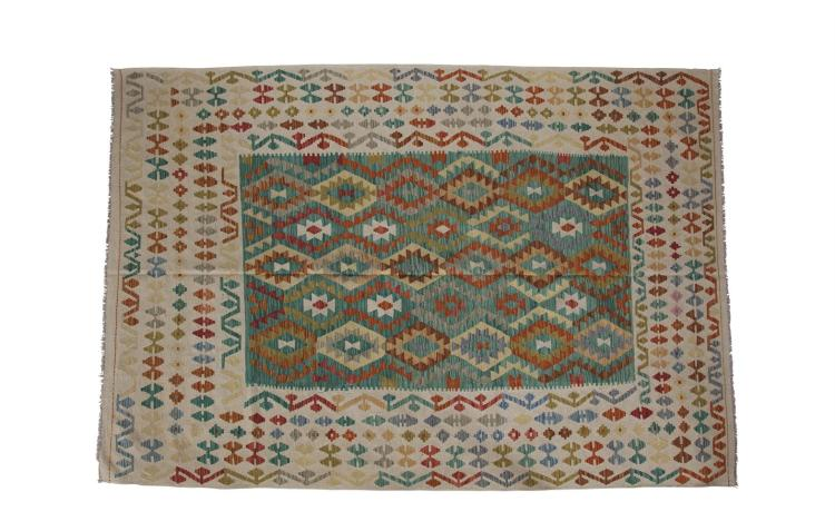 A LARGE FLAT WEAVE KILIM, the large rectangular emerald field with bands of geometrical interlinked diamonds in red, yellow, blue, brown, grey and ivory, within an ivory boarder with scattered multi-colour geometric patterns. 290 x 205cm