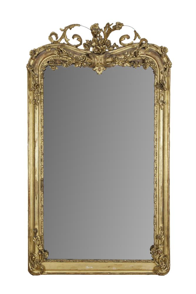 A VICTORIAN GILTWOOD AND GESSO SHAPED RECTANGULAR UPRIGHT PIER MIRROR, the glass plate enclosed with a foliate and beaded boarder, surmounted by scrolling acanthus leaves and roses, the top of the frame and glass plate decorated with trails of floral