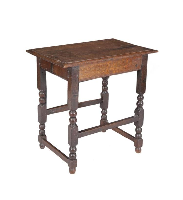 AN IRISH GEORGE IV ROSEWOOD SLENDER ESCRITOIRE, by Williams and Gibton, the rectangular frame with fall front and fitted interior lined in maple, comprising a writing slide, fitted pigeon holes and pen trays, raised on scroll side supports with casto