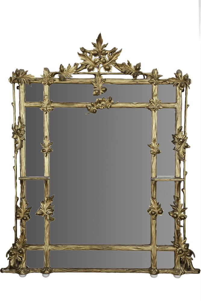 A LATE VICTORIAN CARVED GILTWOOD COMPARTMENTED OVERMANTLE MIRROR, fitted with central rectangular plate, contained within naturalistic borders, flanked by twin brackets, decorated and surmounted with applied oak leaves. 170cm tall, 142cm wide