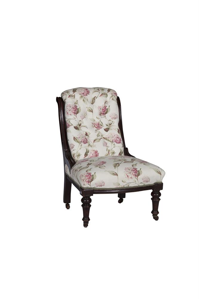A VICTORIAN SCROLL BACK BUTTONED UPHOLSTERED SINGLE CHAIR, raised on mahogany turned legs and casters. 65cm wide