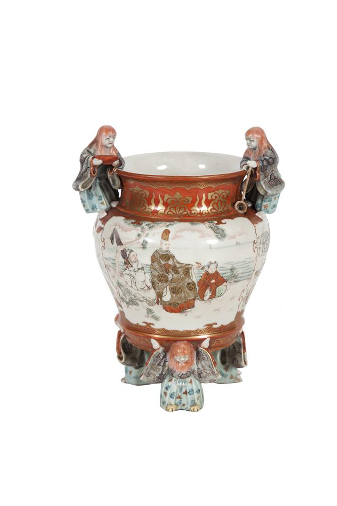 A JAPANESE KUTANI PORCELAIN FIGURAL VASE, late 19th century, painted in the traditional red, gilt and turquoise tones, the rim mounted with toper figures holding a bowl and ladle, the body painted with turtles scouring a sea bed, and dignitaries by t