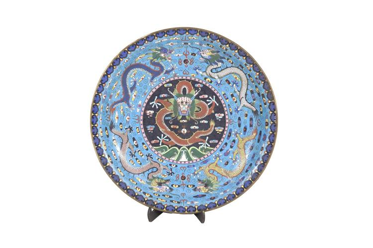 A HEAVY CHINESE BRONZE AND CLOISONNE DECORATED CHARGER, late Qing dynasty, 19th century, of shallow circular form, decorated with dragons in flight against a turquoise enamel ground, encircled by a border of Ruji motifs, corresponding decoration to t